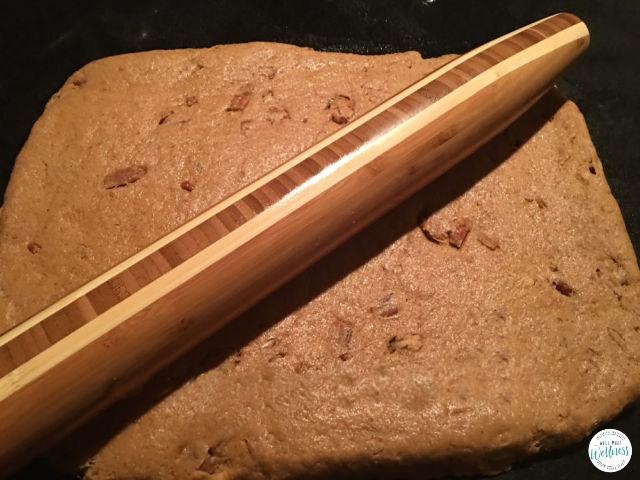 Pumpkin pecan cinnamon rolls, rolling out the dough